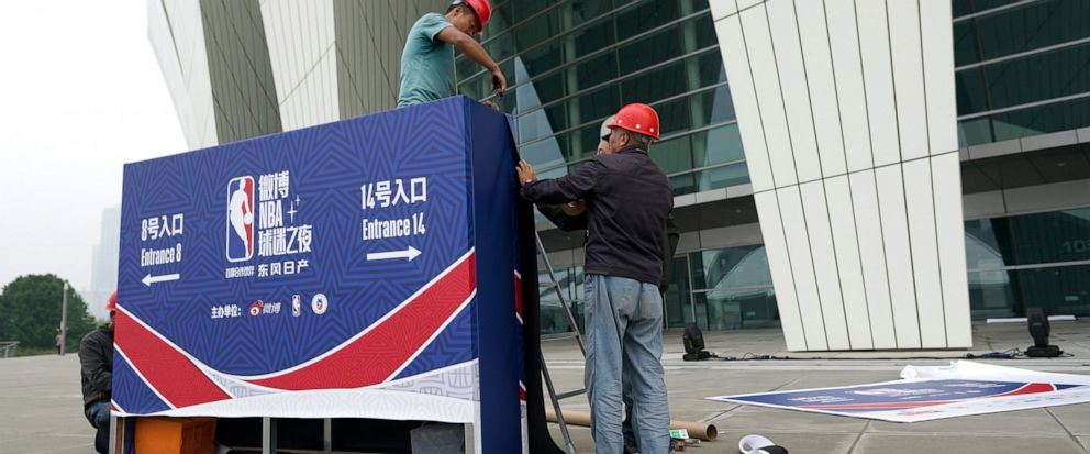 Workers dismantle signage for an NBA fan event scheduled to be held on Wednesday night at the Shanghai Oriental Sports Center in Shanghai, China, Tuesday, Oct. 8, 2019. Chinese state broadcaster CCTV announced Tuesday it will no longer air two NBA pr