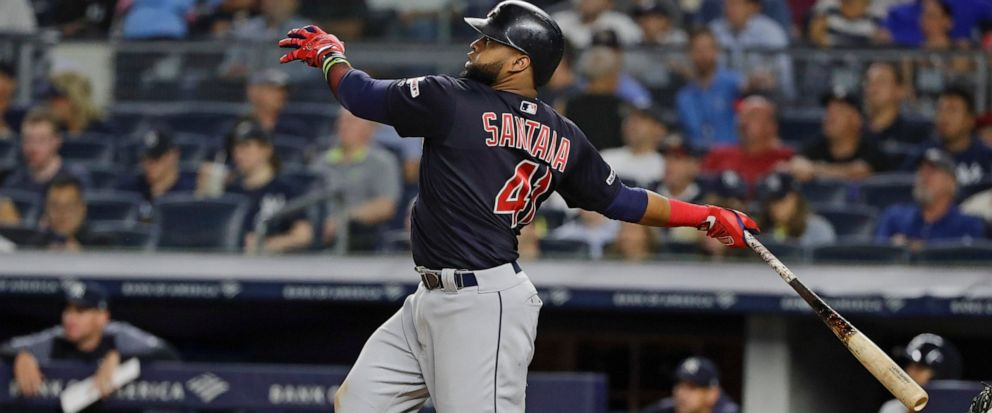 Cleveland Indians Carlos Santana follows through on a two-run home run during the fourth inning of the teams baseball game against the New York Yankees on Thursday, Aug. 15, 2019, in New York. (AP Photo/Frank Franklin II)
