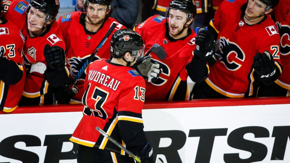 Calgary Flames' Johnny Gaudreau (13) celebrates his penalty-shot goal against the New Jersey Devils during the third period of an NHL hockey game Tuesday, March 12, 2019, in Calgary, Alberta. (Jeff McIntosh/The Canadian Press via AP)