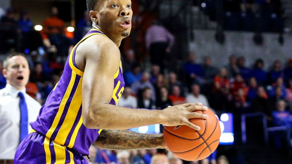 FILE - In this Wednesday, March 6, 2019, file photo, LSU guard Javonte Smart (1) looks for an outlet during the first half of an NCAA college basketball game against Florida in Gainesville, Fla. Smart will play for in the Southeastern Conference Tournament after missing the Tigers' regular-season finale because his name surfaced in reports of a wiretapped phone call that resulted in coach Will Wade's suspension. (AP Photo/Gary McCullough, File)
