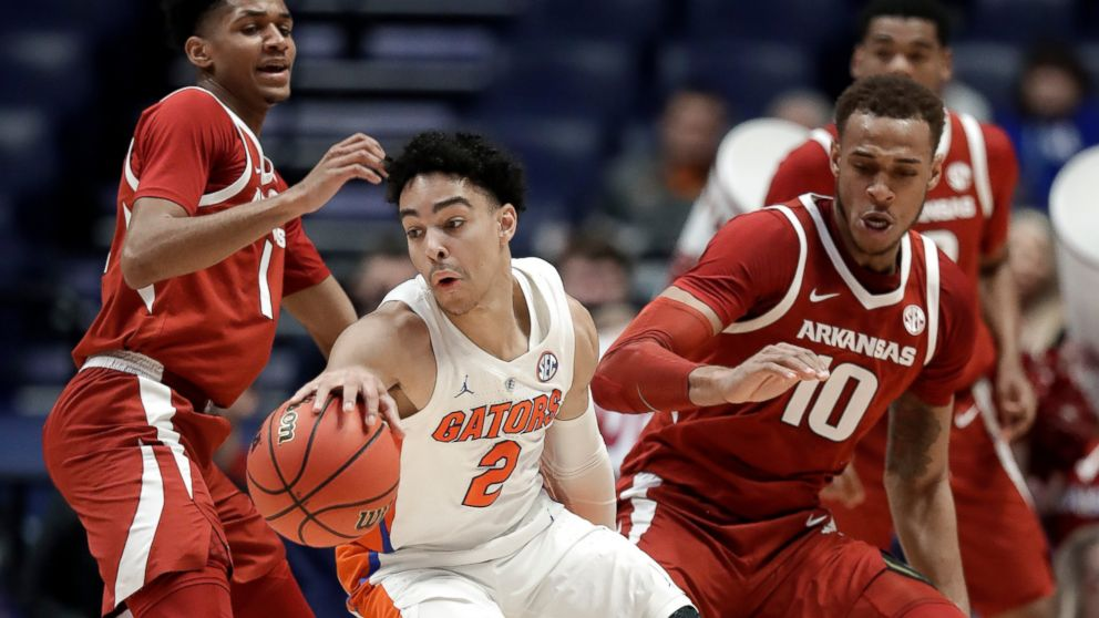 Florida guard Andrew Nembhard (2) moves away from Arkansas forward Daniel Gafford (10) in the first half of an NCAA college basketball game at the Southeastern Conference tournament Thursday, March 14, 2019, in Nashville, Tenn. (AP Photo/Mark Humphrey)