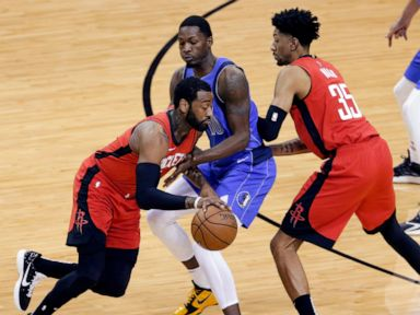 Wall scores 31, Rockets end skid with 102-93 win over Mavs