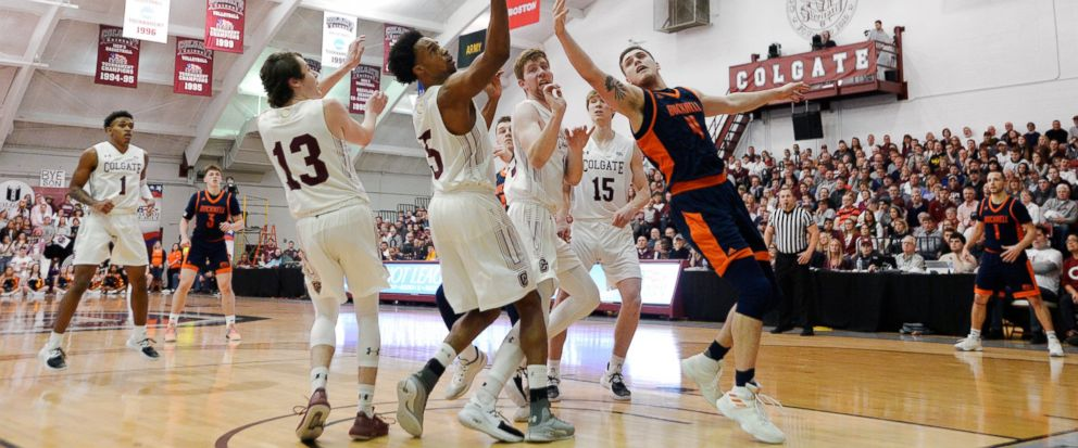 Colgate forward Malcolm Regisford (5) reaches for a rebound next to Bucknell center Nate Sestina (4) during the first half of an NCAA college basketball game for the championship of the Patriot League mens tournament in Hamilton, N.Y., Wednesday, Ma