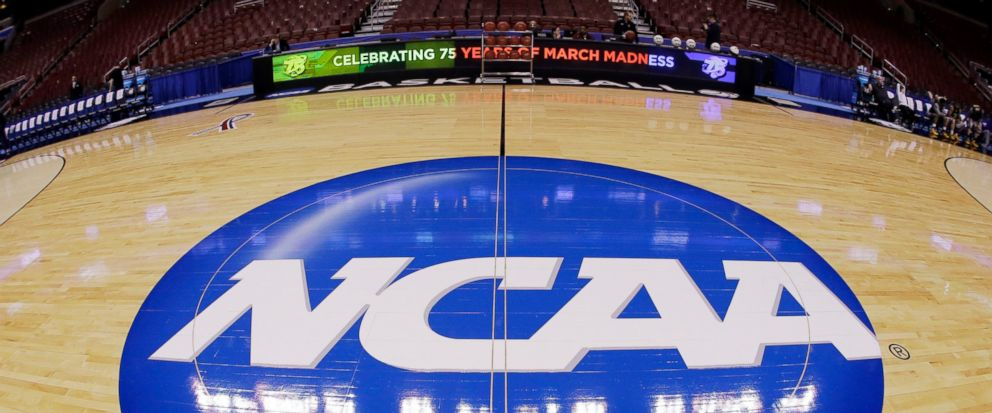 FILE - In this March 21, 2013, file photo taken with a fisheye lens, the NCAA logo is displayed at mid-court before Albanys practice for a second-round game of the NCAA college basketball tournament in Philadelphia. A judge has ruled against the NCA