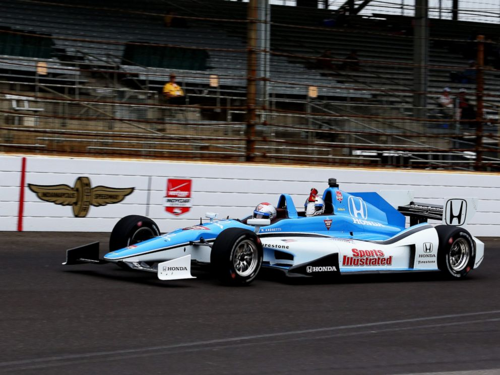 PHOTO: ABCs Matt Gutman, back, took a ride around the Indy 500 race track for Nightline.