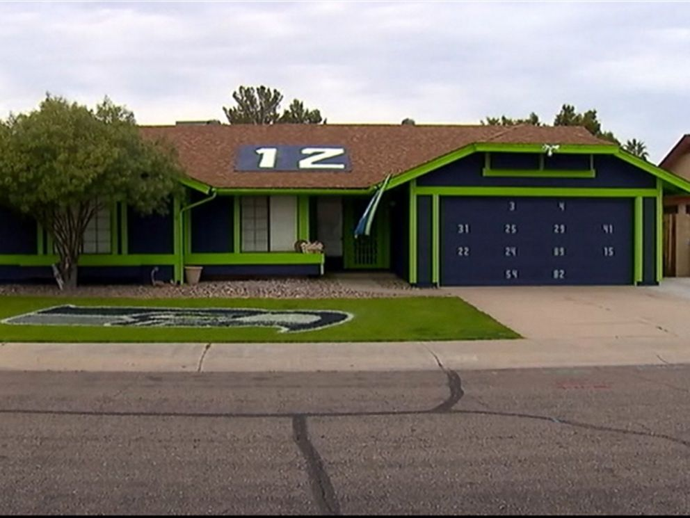 PHOTO: A Seahawks fan painted this home and lawn in Arizona in time for the Super Bowl game in Phoenix on Sunday, Feb. 1.