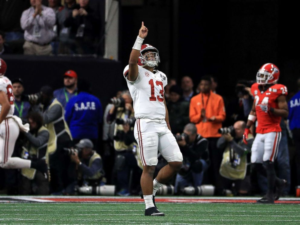PHOTO: Tua Tagovailoa of the Alabama Crimson Tide celebrates a six yard touchdown pass during the third quarter against the Georgia Bulldogs in the CFP National Championship presented, Jan. 8, 2018, in Atlanta.