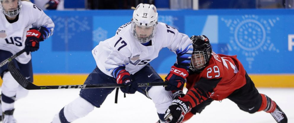 Jocelyne Lamoureux-Davidson (17), of the United States, and Marie-Philip Poulin (29), of Canada, compete for the puck during a preliminary round during a womens hockey game at the 2018 Winter Olympics in Gangneung, South Korea, Thursday, Feb. 15, 2018.
