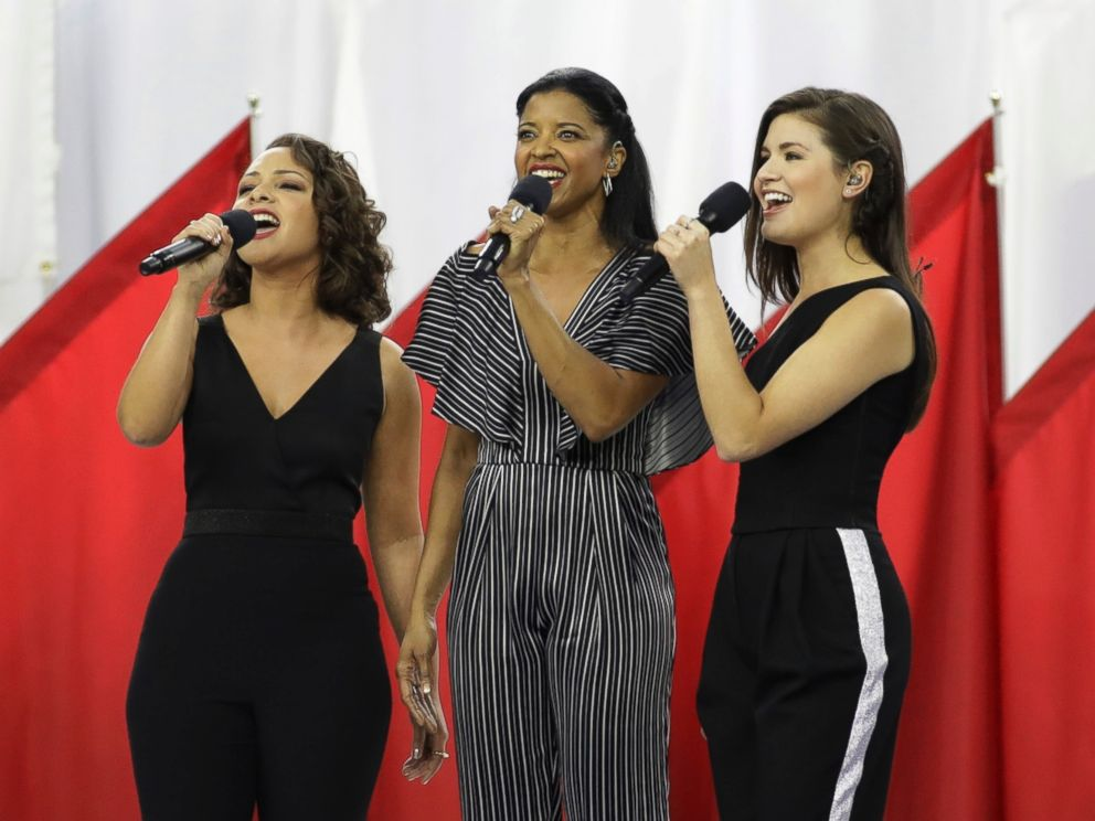 PHOTO: Phillipa Soo, Rene Elise Goldsberry and Jasmine Cephas Jones from the cast of Hamilton sing God Bless America, before the NFL Super Bowl 51 football game between the New England Patriots and the Atlanta Falcons, Feb. 5, 2017, in Houston, Texas.