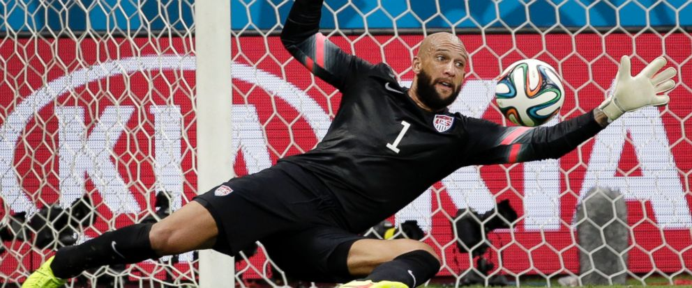 PHOTO: United States goalkeeper Tim Howard saves a shot by Belgium during the World Cup match between Belgium and the USA at the Arena Fonte Nova in Salvador, Brazil, July 1, 2014.