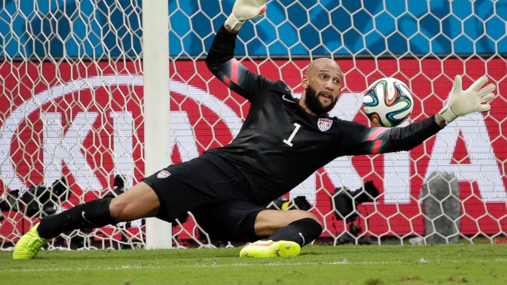 United States' goalkeeper Tim Howard saves a shot by Belgium during the World Cup match between Belgium and the USA at the Arena Fonte Nova in Salvador, Brazil,  July 1, 2014.