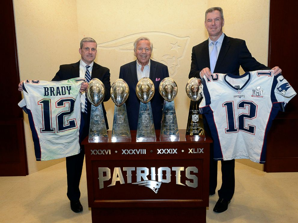 PHOTO: Harold H. Shaw, left, Special Agent in Charge of the FBI Boston Division and Colonel Richard D. McKeon, right, of the Massachusetts State Police, hold two recovered jerseys worn by Tom Brady, team owner Robert Kraft, center, March 23, 2017.