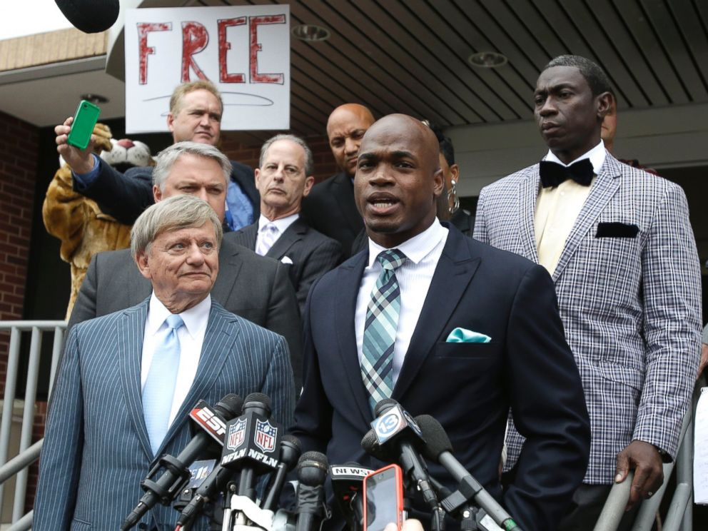 PHOTO: Minnesota Vikings running back Adrian Peterson and his attorney Rusty Hardin speak to the media after pleading no contest to an assault charge, Nov. 4, 2014, in Conroe, Texas.