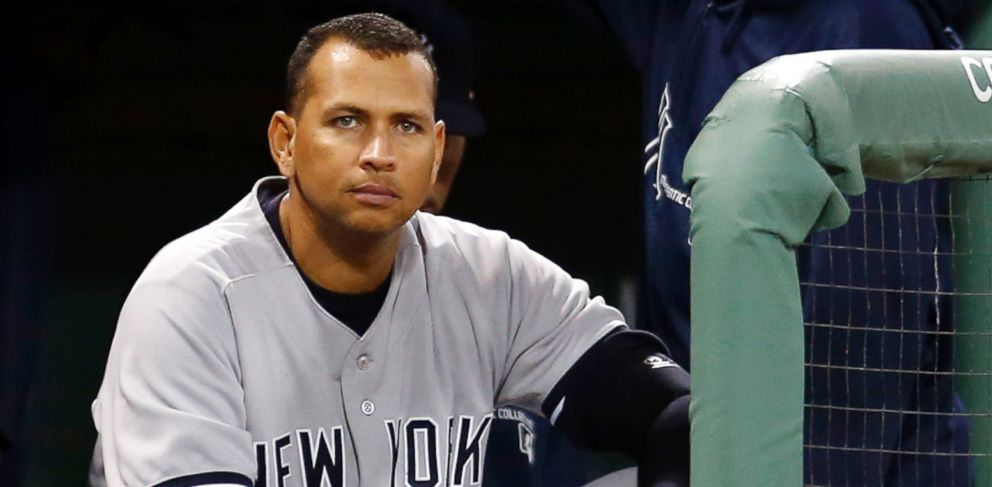 PHOTO: In this Sept. 13, 2013 file photo, New York Yankees Alex Rodriguez sits in the dugout as Derek Jeter stands next to him during the first inning of a baseball game against the Boston Red Sox at Fenway Park in Boston.