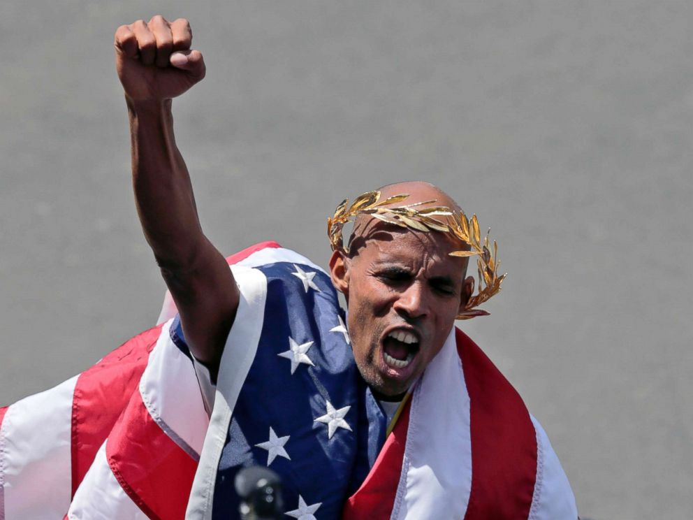 PHOTO: Meb Keflezighi, of San Diego, Calif., celebrates his victory in the 118th Boston Marathon, April 21, 2014 in Boston.