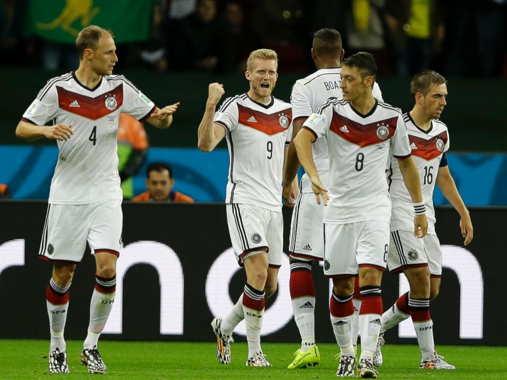 PHOTO: Germanys Andre Schuerrle (9) celebrates with his teammates during the World Cup match between Germany and Algeria at the Estadio Beira-Rio in Porto Alegre, Brazil, June 30, 2014.