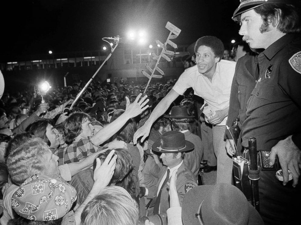 PHOTO: Golden State Warrior Phil Smith, right, gets a hearty reception at San Francisco Airport as the Warriors returned from winning the NBA Championship in Landover, Maryland over the Washington Bullets, May 26, 1975,