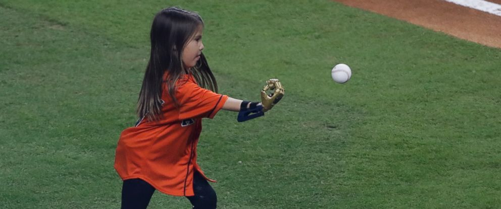PHOTO: Hailey Dawson throws out the ceremonial first pitch with her 3D printed hand before Game 4 of baseballs World Series between the Houston Astros and the Los Angeles Dodgers Saturday, Oct. 28, 2017, in Houston.