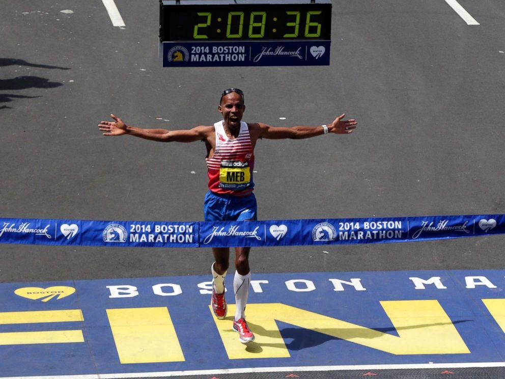 PHOTO: Meb Keflezighi, of San Diego, Calif., celebrates as he crosses the finish line to win the 118th Boston Marathon, April 21, 2014, in Boston.