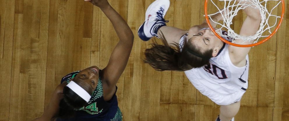 PHOTO: Connecticut forward Breanna Stewart (30) shoots against Notre Dame guard Jewell Loyd (32) during the first half of the championship game in the Final Four of the NCAA womens college basketball tournament, Tuesday, April 8, 2014.