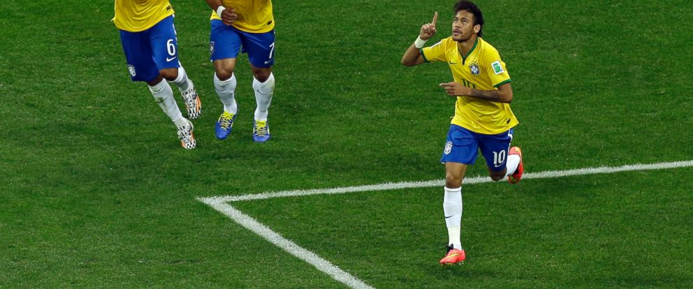 PHOTO: Brazils Neymar, right, celebrates scoring his sides first goal during the group A World Cup soccer match between Brazil and Croatia, the opening game of the tournament, in the Itaquerao Stadium in Sao Paulo, Brazil, June 12, 2014.