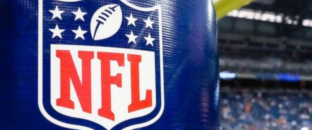 This Aug. 9, 2014 file photo shows an NFL logo on a goal post padding before a preseason NFL game between the Lions and the Browns at Ford Field in Detroit. Several players protested at games Thursday night.