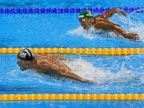 Photo: Michael Phelps, takes the lead in the mens 200-meter butterfly final, Aug. 9, 2016, during the 2016 Rio Olympics.