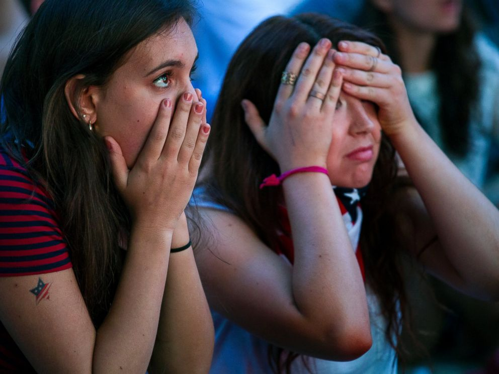 PHOTO: Allison DiFilippo, left, and Samantha Donat, both of New York, react to a last-minute goal at the end of their 2014 World Cup Group G soccer match, while watching a large screen broadcast on Governors Island in New York, June 22, 2014.