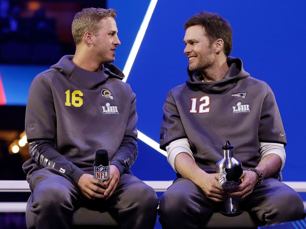 PHOTO: In this Monday, Jan. 28, 2019, file photo, Los Angeles Rams Jared Goff talks to New England Patriots Tom Brady during Opening Night for the NFL Super Bowl 53 football game in Atlanta.