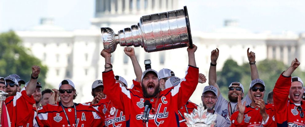 PHOTO: Washington Capitals Alex Ovechkin, from Russia, holds up the Stanley Cup trophy during the NHL hockey teams Stanley Cup victory celebration, June 12, 2018, at the National Mall in Washington.