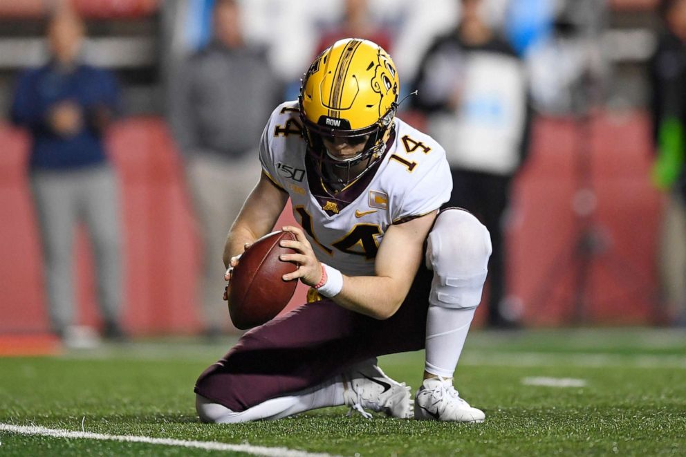 PHOTO: Minnesota Golden Gophers punter Casey OBrien holds the ball for an extra point kick during the second half of an NCAA college football game against Rutgers Saturday, Oct. 19, 2019, in Piscataway, N.J.