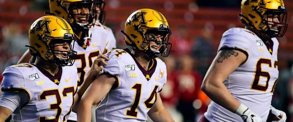 PHOTO: Casey OBrien, #14, of the Minnesota Golden Gophers, a four-time cancer survivor, is lauded for his efforts as holder during the fourth quarter at SHI Stadium on Oct. 19, 2019, in Piscataway, N.J.
