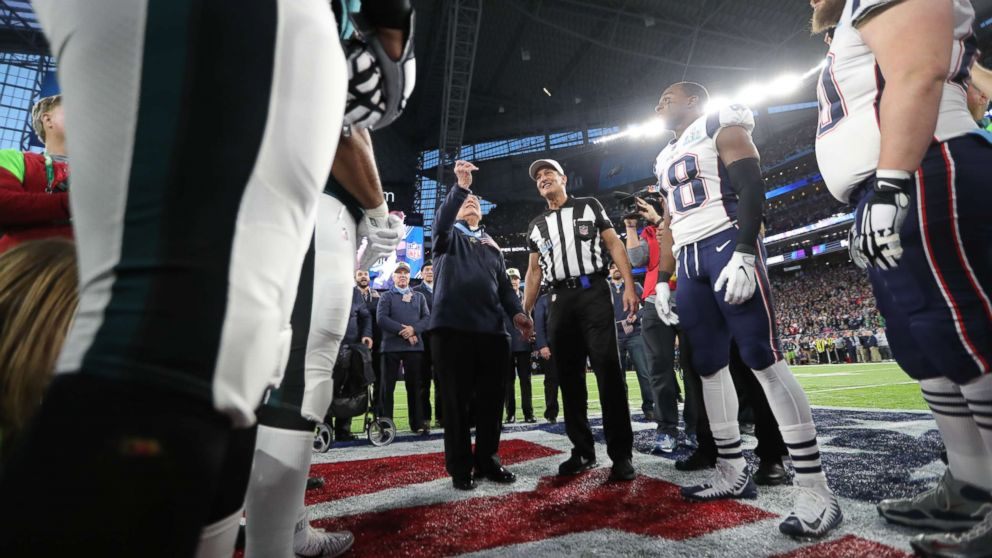 The Philadelphia Eagles and New England Patriots participate in the coin toss prior to the NFL Super Bowl LII football game on Feb. 4, 2018 in Minneapolis.