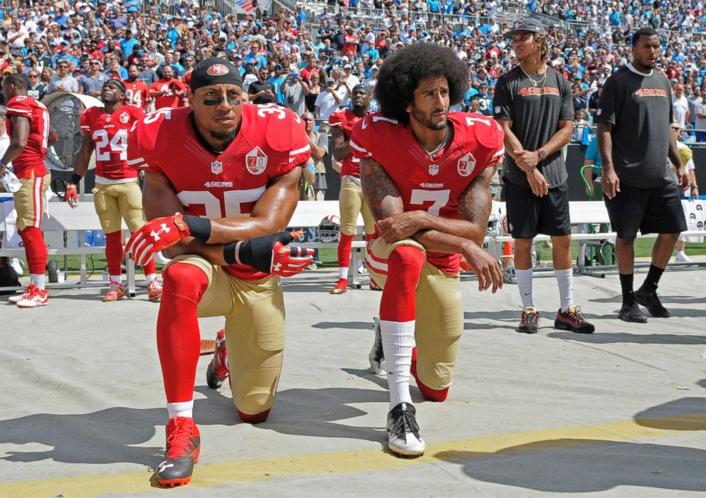 San Francisco 49ers' Colin Kaepernick (7) and Eric Reid (35) kneel during the national anthem before an NFL football game against the Carolina Panthers, in Charlotte, N.C., Sept. 18, 2016.