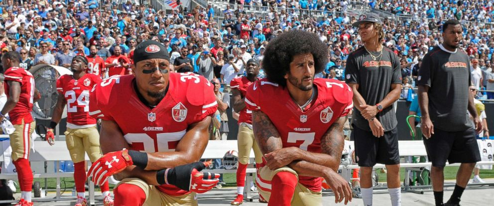 PHOTO: San Francisco 49ers Eric Reid and Colin Kaepernick kneel during the national anthem before an NFL football game against the Carolina Panthers, in Charlotte, N.C., Sept. 18, 2016.