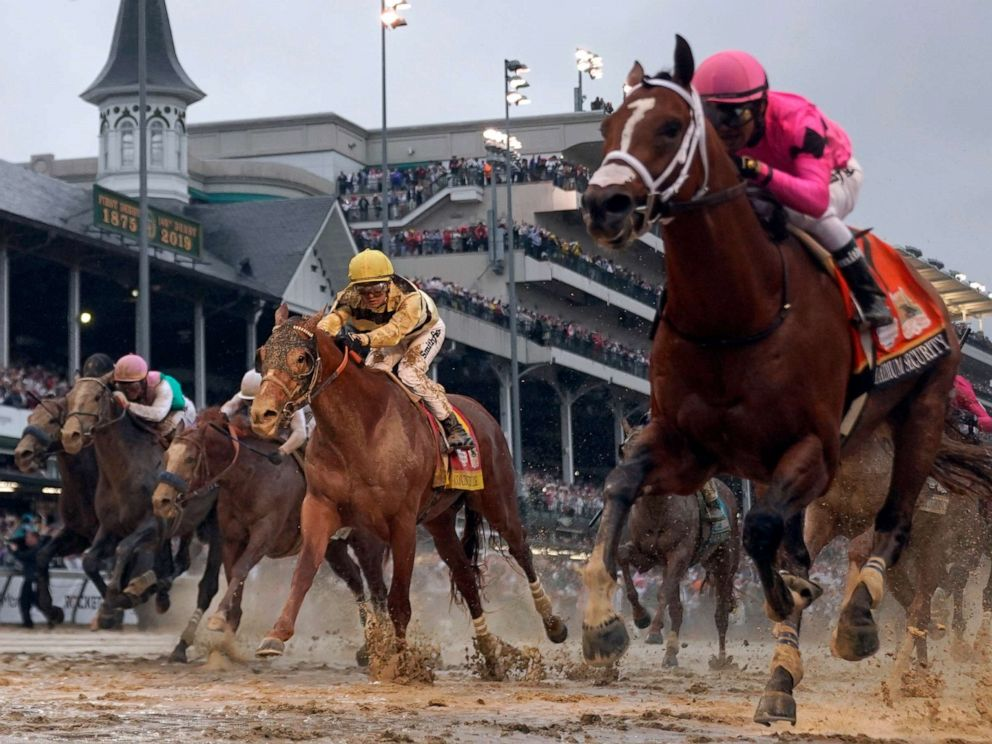 PHOTO: Luis Saez rides Maximum Security, right, across the finish line first as Flavien Prat on Country House comes in behind, center, during the Kentucky Derby at Churchill Downs, May 4, 2019, in Louisville, Ky.