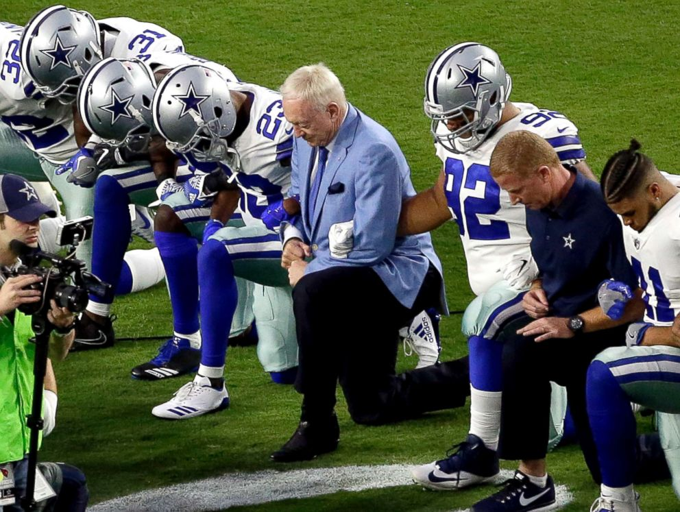 PHOTO: The Dallas Cowboys, led by owner Jerry Jones, center, take a knee prior to the national anthem prior to an NFL football game against the Arizona Cardinals, Sept. 25, 2017, in Glendale, Ariz.