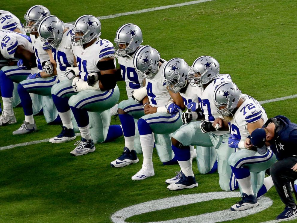 Dallas Cowboys, including owner Jerry Jones, link arms, kneel ahead of national anthem  ABC News