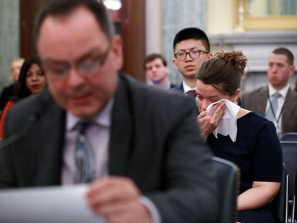PHOTO: A woman weeps while listening to figure skater Craig Maurizi recount his sexual abuse at the hands of his coach when he was 13 years old while testifying before a Senate subcommittee on Capitol Hill April 18, 2018 in Washington.