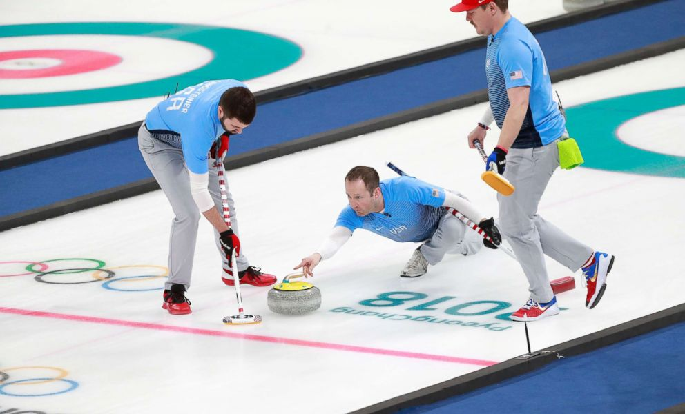 Americans John Landsteiner, skip John Shuster, and Matt Hamilton, left to right, of the U.S. curling team in action during the curling men's gold medal final match between USA and Sweden, Feb. 24, 2018.