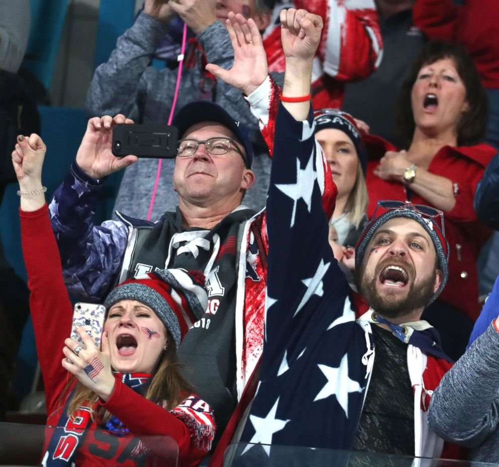 Fans of the U.S. curling team, who were in the stands at Gangneung Centre, react after the U.S. won the gold medal in the men's curling final between Sweden and USA, Feb. 24, 2018.