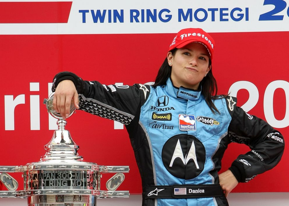 PHOTO: Danica Patrick poses with the trophy after winning the IndyCar Series Bridgestone Indy Japan 300 Mile on April 20, 2008 at Twin Ring Motegi in Motegi, Japan