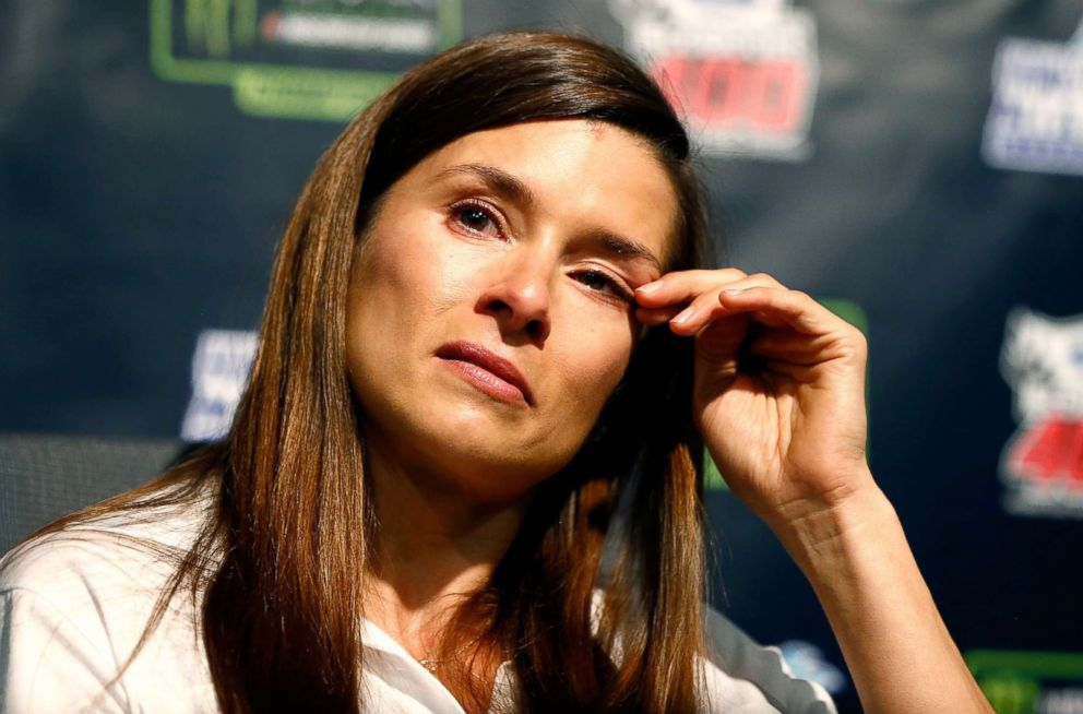 PHOTO: Danica Patrick wipes her face during a press conference announcing her retirement from full-time racing at Homestead-Miami Speedway on Nov. 17, 2017 in Homestead, Fla.