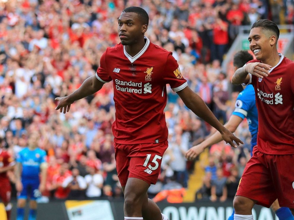 PHOTO: Liverpools Daniel Sturridge, left, celebrates scoring his sides fourth goal of the game against Arsenal during their English Premier League soccer match at Anfield, Liverpool, England, Sunday Aug. 27, 2017.