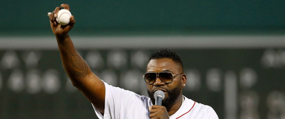 PHOTO: Former Boston Red Sox player David Ortiz talks to the crowd after throwing out the ceremonial first pitch before the game against the New York Yankees at Fenway Park in Boston, Sep 9, 2019.