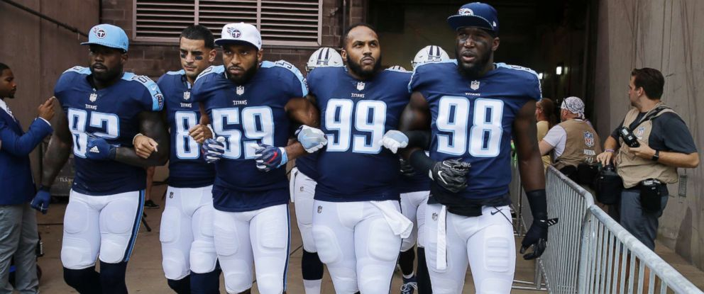 PHOTO: Tennessee Titans Delanie Walker (82), Marcus Mariota (8), Wesley Woodyard (59), Jurrell Casey (99) and Brian Orakpo (98) walk to the field with arms linked after the national anthem had been played in Nashville, Tenn., Sept. 24, 2017.