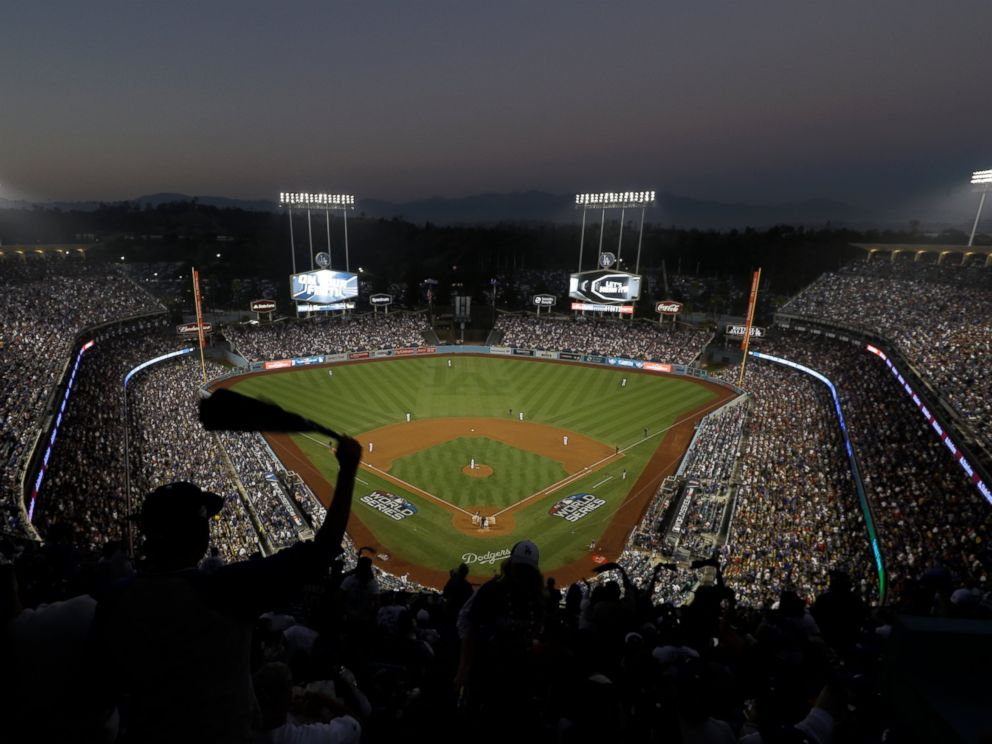 PHOTO: Fans cheer from the top of Dodger Stadium during Game 4 of the World Series baseball game between the Boston Red Sox and Los Angeles Dodgers on Saturday, Oct. 27, 2018, in Los Angeles.