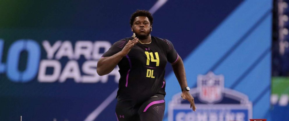 PHOTO: In this March 4, 2018 file photo, Miami defensive lineman Kendrick Norton runs the 40-yard dash at the NFL football scouting combine in Indianapolis.