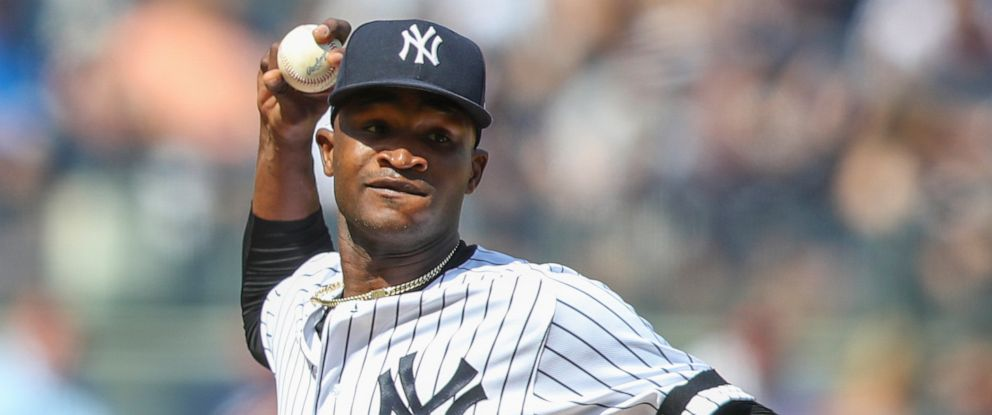 PHOTO: This is an Aug. 31, 2019, file photo showing New York Yankees pitcher Domingo German throwing to first in a pickoff attempt during the fifth inning of a baseball game against the Oakland Athletics, in New York.