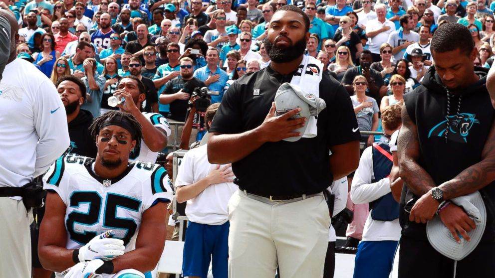 Eric Reid takes a knee during national anthem upon his return to the NFL